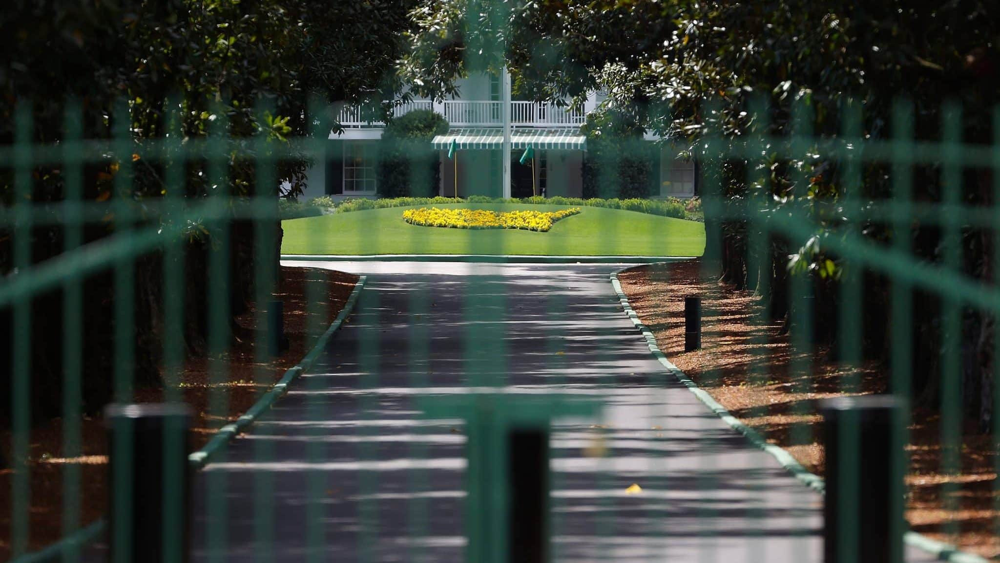 AUGUSTA, GEORGIA - MARCH 30: The gates are locked at the entrance of Magnolia Lane that leads to the clubhouse of Augusta National as the coronavirus pandemic causes closures of venues and nonessential businesses on March 30, 2020 in Augusta, Georgia. The Masters Tournament, the Augusta National Women's Amateur and the Drive, Chip and Putt National Finals has been postponed due to the coronavirus (COVID-19) outbreak.