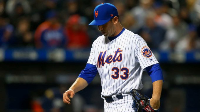 NEW YORK, NY - APRIL 14: Matt Harvey #33 of the New York Mets walks to the dugout after the third inning against the Milwaukee Brewers at Citi Field on April 14, 2018 in the Flushing neighborhood of the Queens borough of New York City.