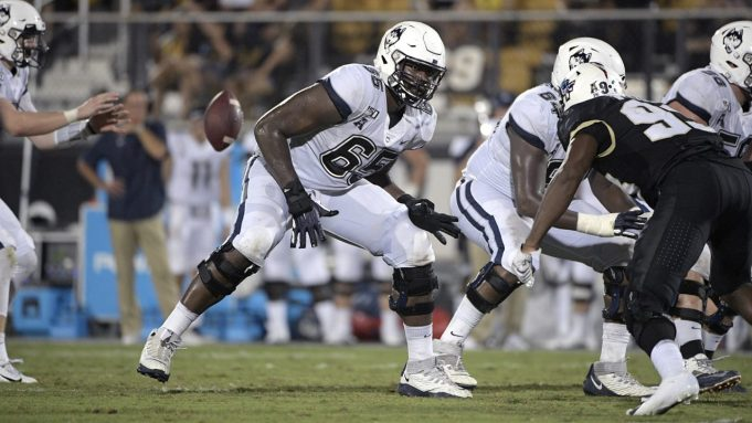 Connecticut offensive lineman Matt Peart (65) sets up to block during the second half of an NCAA college football game against Central Florida Saturday, Sept. 28, 2019, in Orlando, Fla.