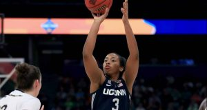 TAMPA, FLORIDA - APRIL 05: Megan Walker #3 of the UConn Huskies attempts a jump shot against the Notre Dame Fighting Irish during the third quarter in the semifinals of the 2019 NCAA Women's Final Four at Amalie Arena on April 05, 2019 in Tampa, Florida.