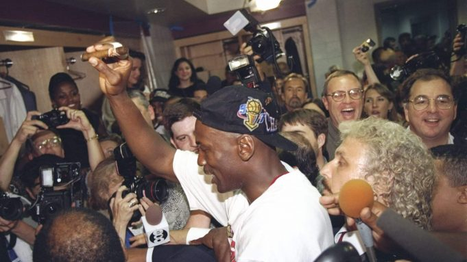 13 Jun 1997: Michael Jordan of the Chicago Bulls celebrates in the locker room after the Bulls win game 6 of the 1997 NBA Finals at the United Center in Chicago, Illinois. The Bulls defeated the Jazz 90-86 to win the series and claim the championship. Ma