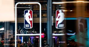 NEW YORK, NY - MARCH 12: An NBA logo is shown at the 5th Avenue NBA store on March 12, 2020 in New York City. The National Basketball Association said they would suspend all games after player Rudy Gobert of the Utah Jazz reportedly tested positive for the Coronavirus (COVID-19).