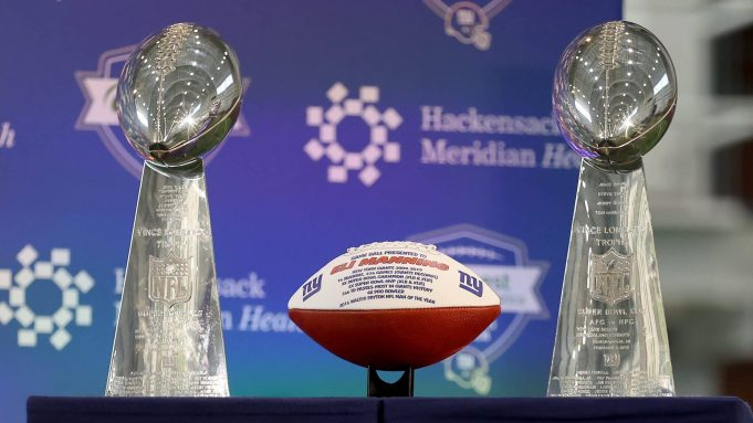 EAST RUTHERFORD, NEW JERSEY - JANUARY 24: A football listing all the accomplishments of Eli Manning of the New York Giants is on display with the Vince Lombardi trophies before Eli Manning announced his retirement during a press conference on January 24, 2020 at Quest Diagnostic Training Center in East Rutherford, New Jersey.The two time Super Bowl MVP is retiring after 16 seasons with the team.