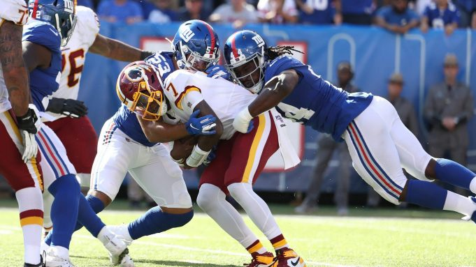 EAST RUTHERFORD, NEW JERSEY - SEPTEMBER 29: Oshane Ximines #53 and Markus Golden #44 of the New York Giants sack Dwayne Haskins #7 of the Washington Redskins during their game at MetLife Stadium on September 29, 2019 in East Rutherford, New Jersey.