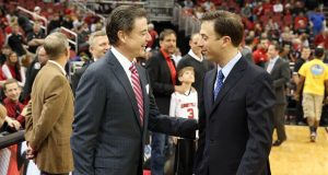 LOUISVILLE, KY - DECEMBER 19: Rick Pitino the head coach of the Louisville Cardinals and Richard Pitino the head coach of the Florida International Panthers meet before the game in the Billy Minardi Classic at KFC YUM! Center on December 19, 2012 in Louisville, Kentucky.