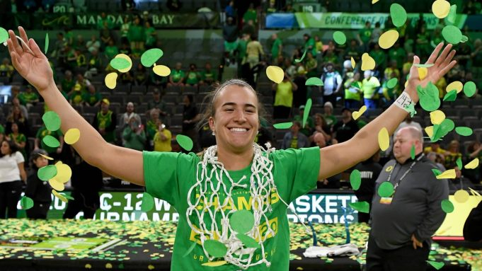 LAS VEGAS, NEVADA - MARCH 08: Sabrina Ionescu #20 of the Oregon Ducks wears a basketball net around her neck and throws confetti in the air as she celebrates her team's 89-56 win over the Stanford Cardinal to win the championship game of the Pac-12 Conference women's basketball tournament at the Mandalay Bay Events Center on March 8, 2020 in Las Vegas, Nevada.
