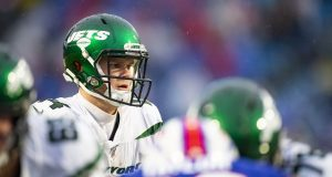 ORCHARD PARK, NY - DECEMBER 29: Sam Darnold #14 of the New York Jets moves behind the line of scrimmage during the fourth quarter against the Buffalo Bills at New Era Field on December 29, 2019 in Orchard Park, New York.