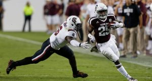 COLLEGE STATION, TX - SEPTEMBER 30: Kendall Bussey #25 of the Texas A&M Aggies rushes past T.J. Brunson #6 of the South Carolina Gamecocks at Kyle Field on September 30, 2017 in College Station, Texas.