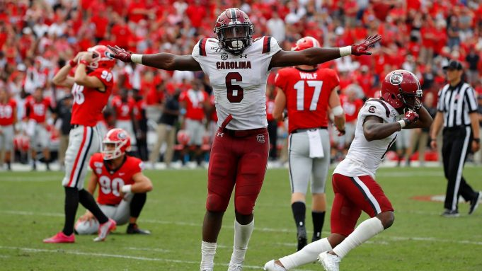 ATHENS, GEORGIA - OCTOBER 12: T.J. Brunson #6 and Jaycee Horn #1 of the South Carolina Gamecocks react after a missed field goal by Rodrigo Blankenship #98 of the Georgia Bulldogs in second overtime gave them a 20-17 win at Sanford Stadium on October 12, 2019 in Athens, Georgia.