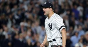 NEW YORK, NY - OCTOBER 18: Tommy Kahnle #48 of the New York Yankees reacts at the end of the top of the eighth inning against the Houston Astros in Game Five of the American League Championship Series at Yankee Stadium on October 18, 2017 in the Bronx borough of New York City.