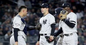 NEW YORK, NEW YORK - OCTOBER 18: Tommy Kahnle #48 of the New York Yankees talks with Gary Sanchez #24 and Didi Gregorius #18 against the Houston Astros during the seventh inning in game five of the American League Championship Series at Yankee Stadium on October 18, 2019 in New York City.