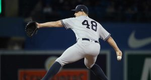 TORONTO, ON - MARCH 30: Tommy Kahnle #48 of the New York Yankees delivers a pitch in the eighth inning during MLB game action against the Toronto Blue Jays at Rogers Centre on March 30, 2018 in Toronto, Canada.