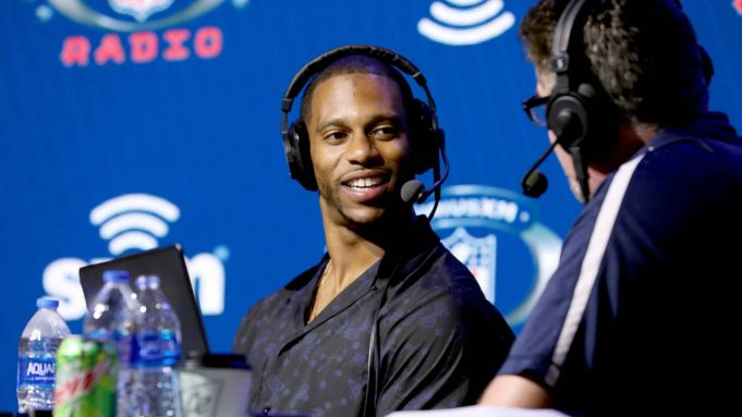 MIAMI, FLORIDA - JANUARY 29: Former NFL player Victor Cruz and SiriusXM host Jim Miller speak onstage during day 1 with SiriusXM at Super Bowl LIV on January 29, 2020 in Miami, Florida.