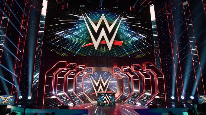 LAS VEGAS, NEVADA - OCTOBER 11: WWE logos are shown on screens before a WWE news conference at T-Mobile Arena on October 11, 2019 in Las Vegas, Nevada. It was announced that WWE wrestler Braun Strowman will face heavyweight boxer Tyson Fury and WWE champion Brock Lesnar will take on former UFC heavyweight champion Cain Velasquez at the WWE's Crown Jewel event at Fahd International Stadium in Riyadh, Saudi Arabia on October 31.