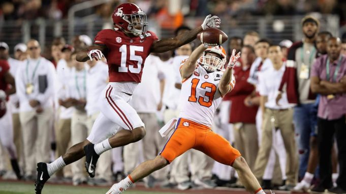 SANTA CLARA, CA - JANUARY 07: Hunter Renfrow #13 of the Clemson Tigers attempts to catch the pass under pressure from Xavier McKinney #15 of the Alabama Crimson Tide in the CFP National Championship presented by AT&T at Levi's Stadium on January 7, 2019 in Santa Clara, California.