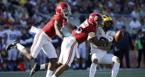 ORLANDO, FL - JANUARY 01: Xavier McKinney #15 and Shyheim Carter #5 of the Alabama Crimson Tide defend a pass against Ronnie Bell #8 of the Michigan Wolverines in the third quarter of the Vrbo Citrus Bowl at Camping World Stadium on January 1, 2020 in Orlando, Florida. Alabama defeated Michigan 35-16.