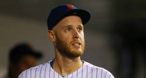 NEW YORK, NY - SEPTEMBER 15: Pitcher Zack Wheeler #45 of the New York Mets looks on from the dugout during the seventh inning of a game against the Los Angeles Dodgers at Citi Field on September 15, 2019 in New York City.