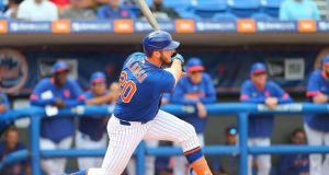 PORT ST. LUCIE, FL - MARCH 08: Pete Alonso #20 of the New York Mets hits an RBI double against the Houston Astros during the fifth inning of a spring training baseball game at Clover Park on March 8, 2020 in Port St. Lucie, Florida. The Mets defeated the Astros 3-1.