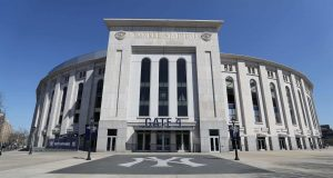 """BRONX, NEW YORK - MARCH 26: Yankee Stadium is empty on the scheduled date for Opening Day March 26, 2020 in the Bronx, New York. Major League Baseball has postponed the start of its season due to the coronavirus (COVID-19) outbreak and MLB commissioner Rob Manfred recently said the league is """"probably not gonna be able to"""" play a full 162-game regular season."""