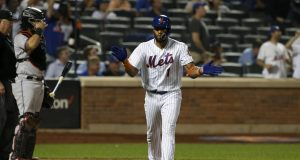 NEW YORK, NEW YORK - SEPTEMBER 23: Amed Rosario #1 of the New York Mets reacts after his sixth inning grand slam home run against the Miami Marlins at Citi Field on September 23, 2019 in New York City.