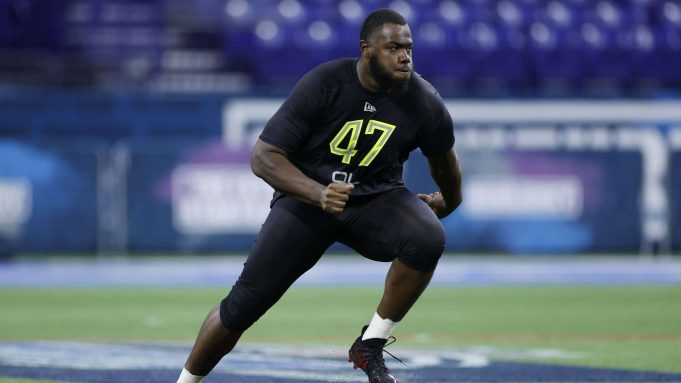 INDIANAPOLIS, IN - FEBRUARY 28: Offensive lineman Andrew Thomas of Georgia runs a drill during the NFL Combine at Lucas Oil Stadium on February 28, 2020 in Indianapolis, Indiana.