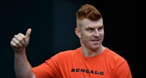 MIAMI, FLORIDA - DECEMBER 22: Andy Dalton #14 of the Cincinnati Bengals gestures to the fans prior to the game against the Miami Dolphins at Hard Rock Stadium on December 22, 2019 in Miami, Florida.