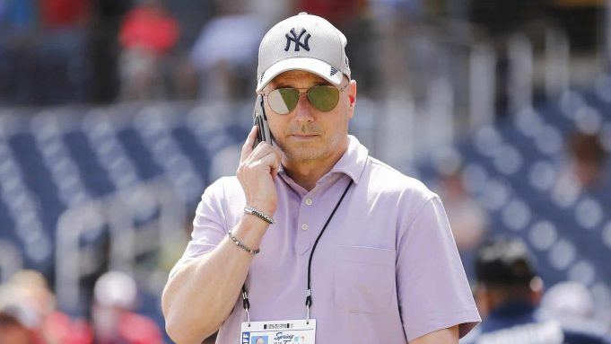 WEST PALM BEACH, FLORIDA - MARCH 12: New York Yankees general manager Brian Cashman talks on the phone prior to a Grapefruit League spring training game between the Washington Nationals and the New York Yankees at FITTEAM Ballpark of The Palm Beaches on March 12, 2020 in West Palm Beach, Florida. Many professional and college sports are canceling or postponing their games due to the ongoing threat of the Coronavirus (COVID-19) outbreak.