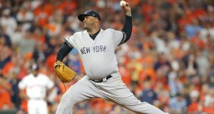 HOUSTON, TEXAS - OCTOBER 13: CC Sabathia #52 of the New York Yankees pitches during the tenth inning against the Houston Astros in game two of the American League Championship Series at Minute Maid Park on October 13, 2019 in Houston, Texas.