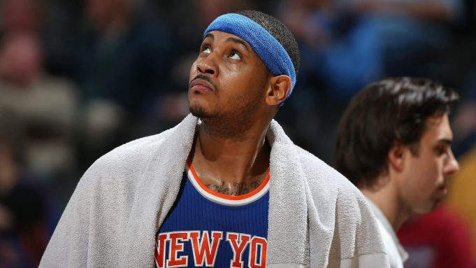DENVER, CO - MARCH 08: Carmelo Anthony #7 of the New York Knicks looks on as he sits on the bench late in the game against the Denver Nuggets at Pepsi Center on March 8, 2016 in Denver, Colorado. The Nuggets defeated the Knicks 110-94. NOTE TO USER: User expressly acknowledges and agrees that, by downloading and or using this photograph, User is consenting to the terms and conditions of the Getty Images License Agreement.