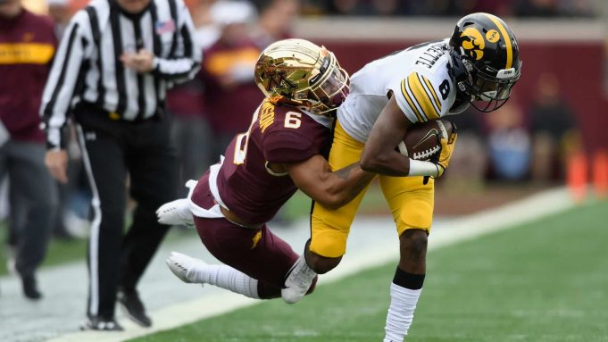 MINNEAPOLIS, MN - OCTOBER 06: Chris Williamson #6 of the Minnesota Golden Gophers pulls Ihmir Smith-Marsette #6 of the Iowa Hawkeyes out of bounds during the first quarter of the game on October 6, 2018 at TCF Bank Stadium in Minneapolis, Minnesota.