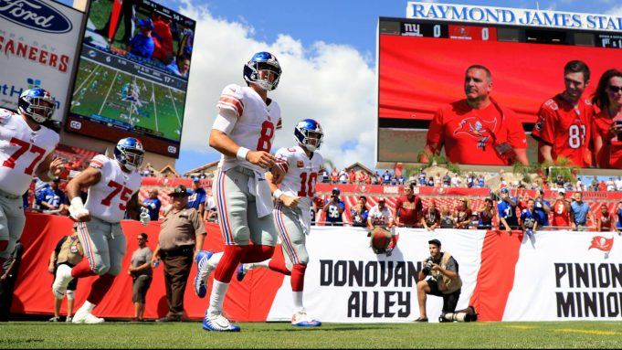TAMPA, FLORIDA - SEPTEMBER 22: Teammates Daniel Jones #8 and Eli Manning #10 of the New York Giants take the field to warm up before their game against the Tampa Bay Buccaneers at Raymond James Stadium on September 22, 2019 in Tampa, Florida.