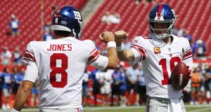 TAMPA, FLORIDA - SEPTEMBER 22: Quarterbacks Daniel Jones #8 and Eli Manning #10 of the New York Giants fist bump during warmups before the game against the Tampa Bay Buccaneers at Raymond James Stadium on September 22, 2019 in Tampa, Florida.