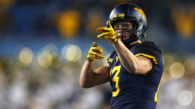 MORGANTOWN, WV - OCTOBER 25: David Sills V #13 of the West Virginia Mountaineers reacts after a first down in the first half against the Baylor Bears at Mountaineer Field on October 25, 2018 in Morgantown, West Virginia.