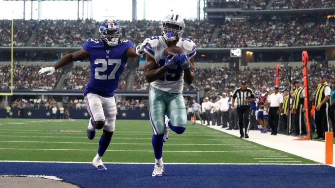 ARLINGTON, TEXAS - SEPTEMBER 08: Wide receiver Amari Cooper #19 of the Dallas Cowboys makes the recption for a touchdown in front of cornerback Deandre Baker #27 of the New York Giants during the second quarter of the game at AT&T Stadium on September 08, 2019 in Arlington, Texas.