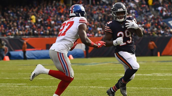 CHICAGO, ILLINOIS - NOVEMBER 24: Tarik Cohen #29 of the Chicago Bears is pursued by Deandre Baker #27 of the New York Giants during the first half at Soldier Field on November 24, 2019 in Chicago, Illinois.