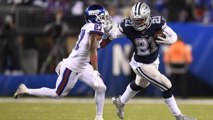 EAST RUTHERFORD, NEW JERSEY - NOVEMBER 04: Ezekiel Elliott #21 of the Dallas Cowboys carries the ball as Deandre Baker #27 of the New York Giants defends during the fourth quarter of the game at MetLife Stadium on November 04, 2019 in East Rutherford, New Jersey.
