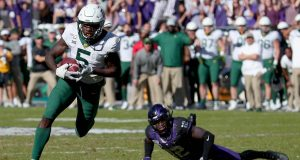 FORT WORTH, TEXAS - NOVEMBER 09: Denzel Mims #5 of the Baylor Bears scores a touchdown against Jeff Gladney #12 of the TCU Horned Frogs in the second overtime period at Amon G. Carter Stadium on November 09, 2019 in Fort Worth, Texas.
