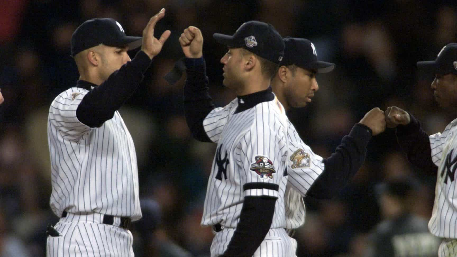 30 Oct 2001: Bernie Williams #51, Derek Jeter #2, Alfonso Soriano #33, and David Justice #28 of the New York Yankees celebrate after defeating the Arizona Diamondbacks in game 3 of the World Series at Yankee Stadium in New York, New York. The Yankees defeated the Diamondbacks 2-1. DIGITAL IMAGE