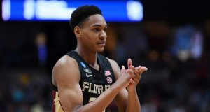 ANAHEIM, CALIFORNIA - MARCH 28: Devin Vassell #24 of the Florida State Seminoles cheers after a play against the Gonzaga Bulldogs during the 2019 NCAA Men's Basketball Tournament West Regional at Honda Center on March 28, 2019 in Anaheim, California.