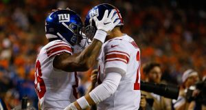 DENVER, CO - OCTOBER 15: Quarterback Eli Manning #10 of the New York Giants congratulates Evan Engram #88 after he scored a touchdown during the second quarter at Sports Authority Field at Mile High on October 15, 2017 in Denver, Colorado.