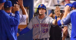 MIAMI, FL - AUGUST 10: Jeff McNeil #68 of the New York Mets celebrates with teammates in the dugout after scoring a run in the third inning against the Miami Marlins at Marlins Park on August 10, 2018 in Miami, Florida.