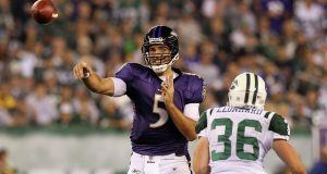 EAST RUTHERFORD, NJ - SEPTEMBER 13: Joe Flacco #5 of the Baltimore Ravens throws a pass against the New York Jets during the home opener at the New Meadowlands Stadium on September 13, 2010 in East Rutherford, New Jersey.