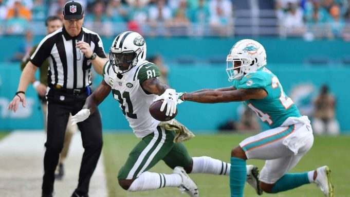 MIAMI, FL - NOVEMBER 04: Quincy Enunwa #81 of the New York Jets tries to avoid the tackle of Torry McTyer #24 of the Miami Dolphins in the first half of their game at Hard Rock Stadium on November 4, 2018 in Miami, Florida.