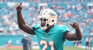 MIAMI, FL - NOVEMBER 04: Frank Gore #21 of the Miami Dolphins takes the field for their game against the New York Jets of their game at Hard Rock Stadium on November 4, 2018 in Miami, Florida.