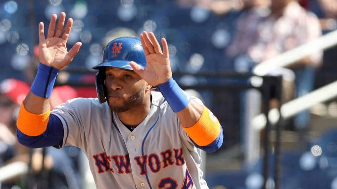 WASHINGTON, DC - SEPTEMBER 04: Robinson Cano #24 of the New York Mets motions for the runner to slide during the sixth inning against the Washington Nationals at Nationals Park on September 04, 2019 in Washington, DC.
