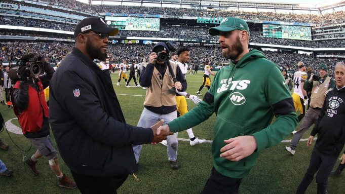 EAST RUTHERFORD, NEW JERSEY - DECEMBER 22: Head coach Mike Tomlin of the Pittsburgh Steelers meets head coach Adam Gase of the New York Jets after the Jets 16-10 win at MetLife Stadium on December 22, 2019 in East Rutherford, New Jersey.
