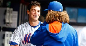 NEW YORK, NY - JUNE 28: Steven Matz #32 of the New York Mets has a laugh after the sixth inning against the Cincinnati Reds with teammate Jacob deGrom #48 at Citi Field on June 28, 2015 in the Flushing neighborhood of the Queens borough of New York City.