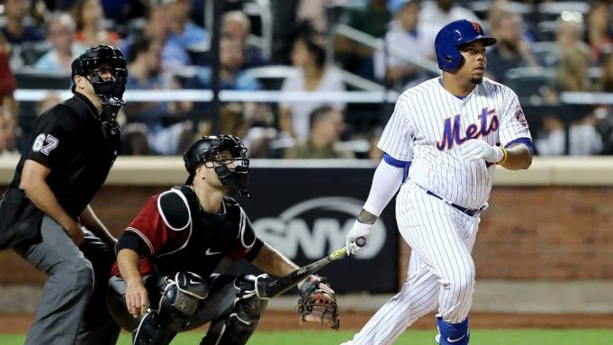 NEW YORK, NY - AUGUST 23: Dominic Smith #22 of the New York Mets hits a solo home run in the sixth inning as Chris Iannetta #8 of the Arizona Diamondbacks defends on August 23, 2017 at Citi Field in the Flushing neighborhood of the Queens borough of New York City.