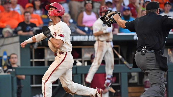 Omaha, NE - JUNE 27: Infielder Casey Martin #15 of the Arkansas Razorbacks celebrates after scoring a run in the fifth inning against the Oregon State Beavers during game two of the College World Series Championship Series on June 27, 2018 at TD Ameritrade Park in Omaha, Nebraska. New York Mets