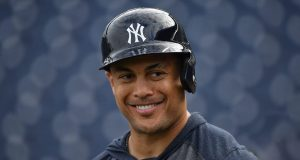TAMPA, FLORIDA - FEBRUARY 24: Giancarlo Stanton #27 of the New York Yankees smiling with teammates during batting practice prior to the spring training game against the Pittsburgh Pirates at Steinbrenner Field on February 24, 2020 in Tampa, Florida.